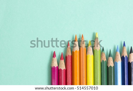 background from color pencils on green paper Royalty-Free Stock Photo #514557010