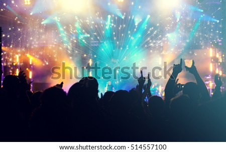 New Year concept - fireworks and cheering crowd celebrating the New year #514557100