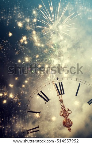New Year's at midnight - Old clock with fireworks and holiday lights #514557952