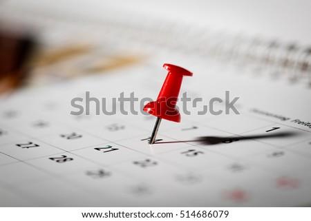 pushpin marking the calendar #514686079