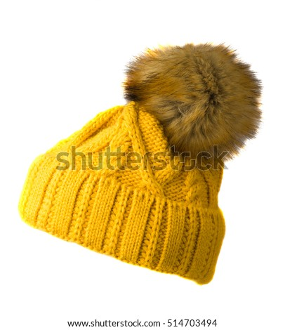 Women's knitted hat isolated on white background.hat with pompon . yellow hat .