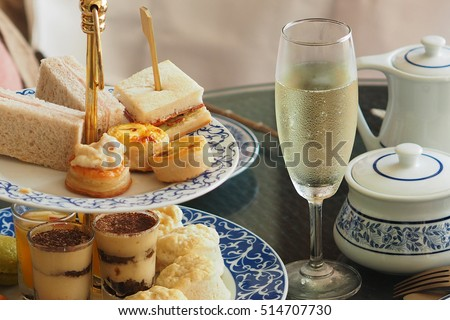 luxury afternoon tea with a sparkling wine Royalty-Free Stock Photo #514707730