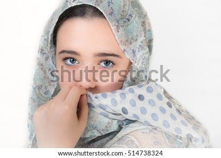 Portrait of young woman covered with a headscarf. #514738324