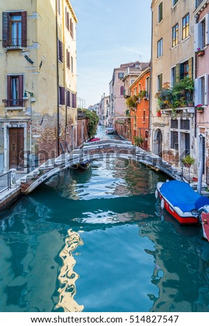 Streetview with bridge and old buildings in Venice Italy. #514827547