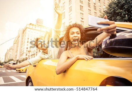 Happy couple driving in New york on a yellow cab and taking selfie with smart phone #514847764