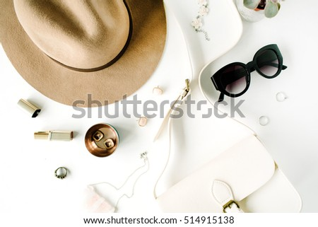 Flat lay trendy creative feminine accessories arrangement. Purse, hat, sunglasses, female accessories. Top view #514915138