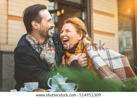 Man and woman dating in cafe Royalty-Free Stock Photo #514951309