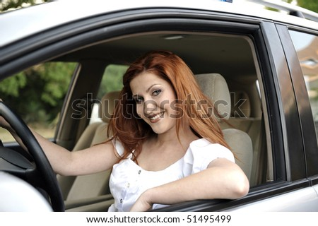 Woman driving car and smiling to camera #51495499