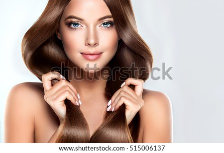 Beautiful model girl with shiny brown straight long  hair . Care and hair products . Royalty-Free Stock Photo #515006137