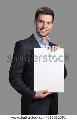 Portrait of a Man with a sign on a gray background #515052391