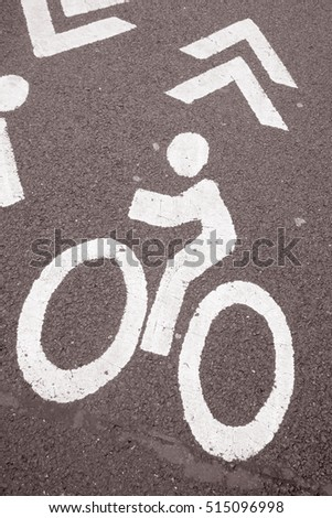 Bike Sign on Road Surface in Black and White Sepia Tone #515096998
