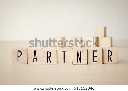 Partner word on wooden cubes background, business concept #515112046