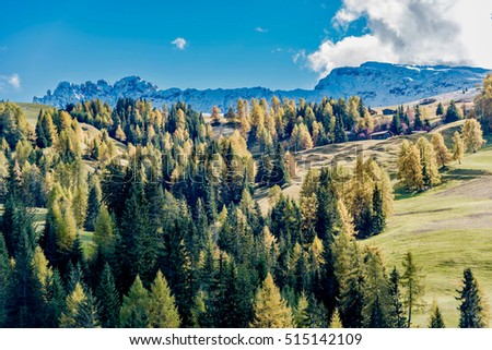 DOLOMITES, ITALY - OCTOBER 20, 2016 -  Beautiful Scenery from Alpe di Siusi, Italy in autumn  light with small wooden cottage and sharp mountains of dolomite. #515142109