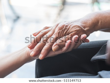 Parkinson disease patient, Alzheimer elderly senior, Arthritis person's hand in support of nursing family caregiver care for disability awareness day, National care givers month, aging society concept #515149753
