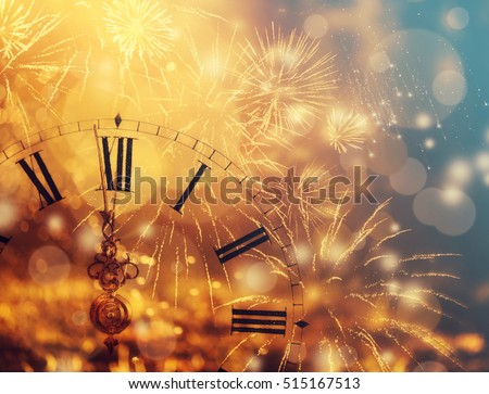 New Year's at midnight - Old clock with fireworks and holiday lights #515167513