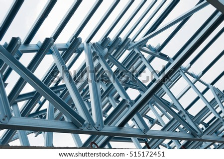 Structure of steel roof frame for building construction on sky background. #515172451