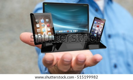 Businessman on blurred background holding laptop phone and tablet in his hand 3D rendering #515199982