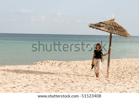 Woman on the beach with long shadow #51523408