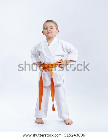With orange belt athlete on a white background #515243806