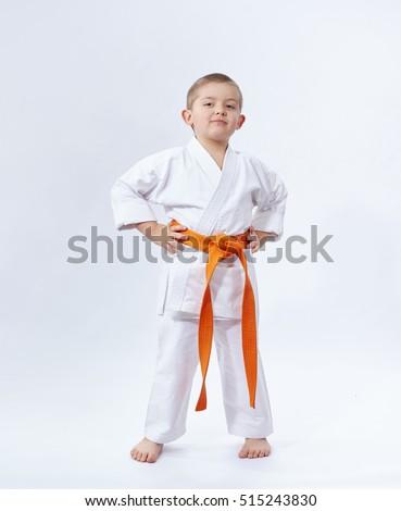 On a white background little athlete in karategi #515243830