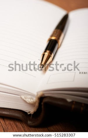 pen and diary closeup #515283307