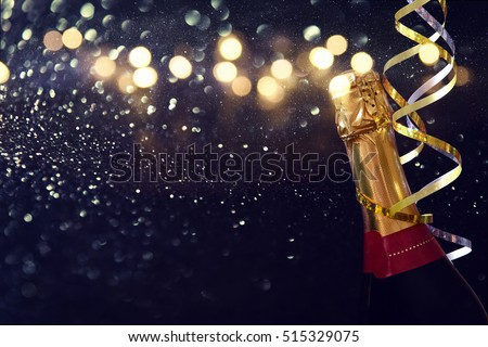 Abstract image of champagne bottle and festive lights. New year and celebration concept