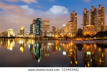 Bangkok twilight, Business building with light and reflection, view from Benjakitti park in Bangkok, Thailand #515443402