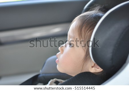 Asain girl seat on carseat #515514445