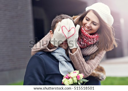 Picture showing young couple with flowers dating in the city