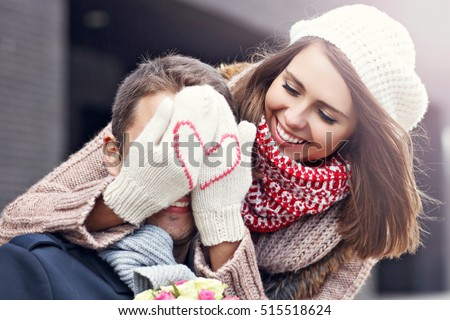 Picture showing young couple with flowers dating in the city Royalty-Free Stock Photo #515518624