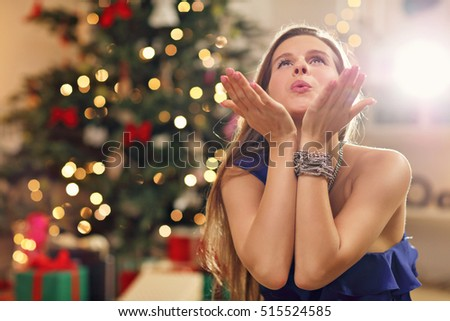 Picture showing happy woman sitting over Christmas tree