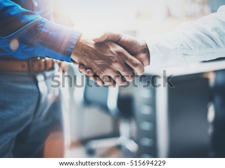 Close up view of business partnership handshake concept.Photo of two businessman handshaking process.Successful deal after great meeting.Horizontal,flare effect, blurred background Royalty-Free Stock Photo #515694229