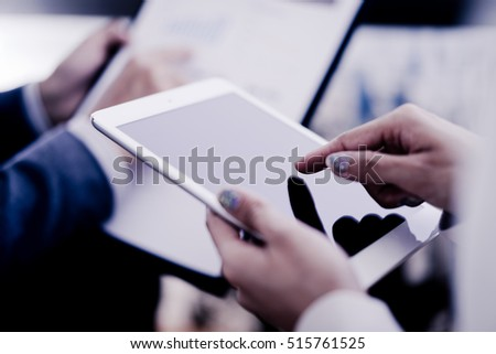 Business adviser analyzing financial figures denoting the progress in the work of the company #515761525