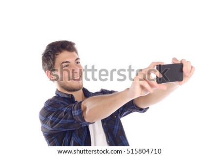 Portrait of a young man taking selfie with smartphone. Isolated white background. #515804710