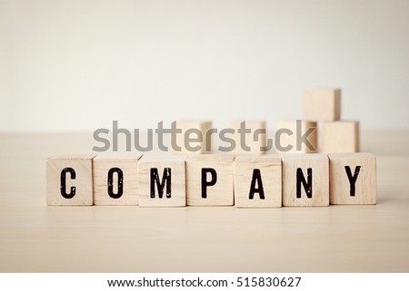 Company word on wooden cubes background, business concept #515830627