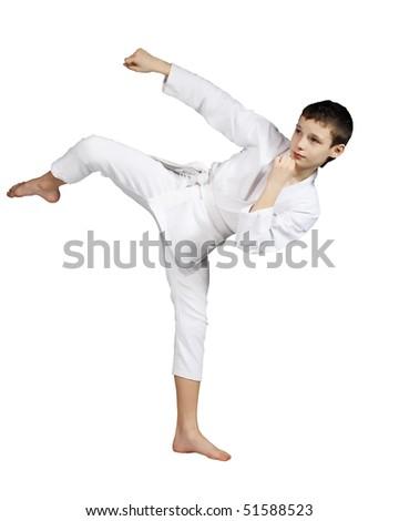 Karate boy exercising against white background #51588523