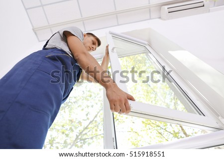 Construction worker installing window in house #515918551