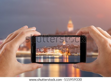 Travel concept. Hands making photo of night city with smartphone camera. Istanbul at sunset. Turkey. #515959330