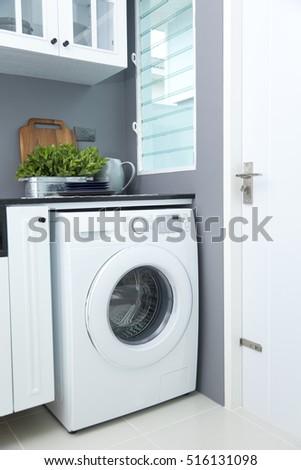 washing machine in a kitchen room #516131098