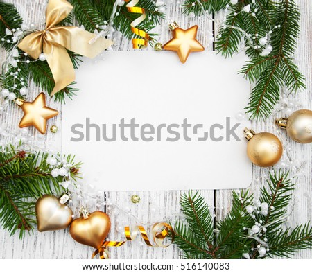 christmas background -  decorations  and fir branch on a wooden table #516140083