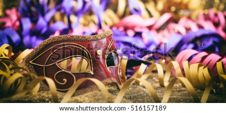 Carnival mask on colorful blur party background #516157189