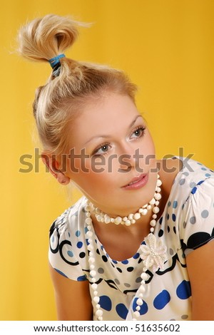 Portrait of the beautiful girl with necklace close-up #51635602