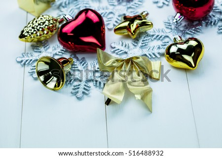 Seasonal Christmas ornaments and snowflakes on white wood background #516488932