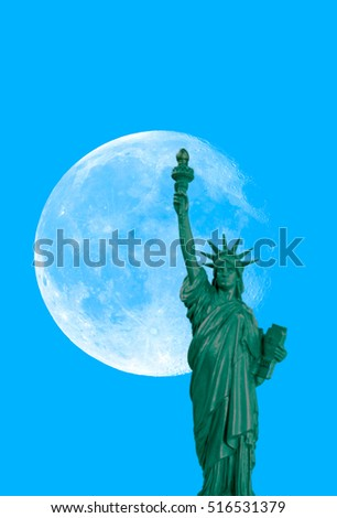 "SELECTIVE FOCUS - Statue of Liberty and a rising supermoon in New York City  ""Elements of this image furnished by NASA "" #516531379"