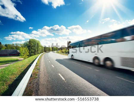 Bus on asphalt road in beautiful spring day at countryside #516553738