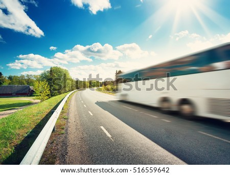 Bus on asphalt road in beautiful spring day at countryside #516559642