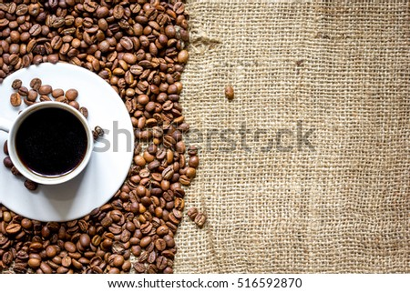 coffee beans, coffe cup on linen cloth background top view #516592870