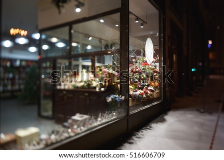 Moscow, Russia. Flower shop window at night. The pavement is covered with snow #516606709