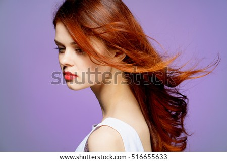Young well-groomed woman. The Woman in White. Woman in profile on a purple background. beauty and health #516655633