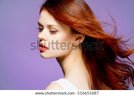 Young well-groomed woman. The Woman in White. Woman in profile on a purple background. beauty and health #516655687